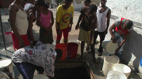 People get water from a well following a massive e Stock Video Footage
