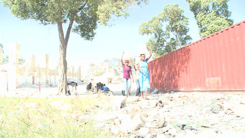 Women carry water through the rubble following the Stock Video Footage
