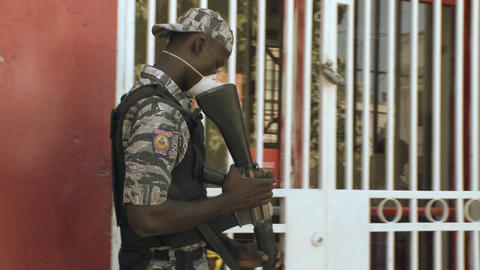 Armed military guards outside a secure area in Hai Stock Video Footage