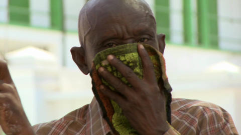 A refugee in Haiti covers his face following the d Stock Video Footage