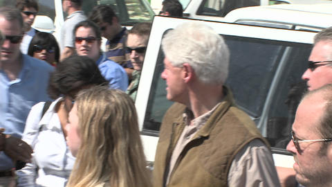 Bill and Chelsea Clinton visit refugees during the Stock Video Footage