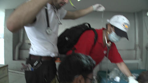Doctors operate on injured victims of the Haiti ea Stock Video Footage