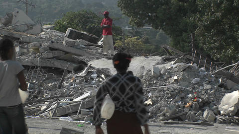 People sift through the rubble following the Haiti Footage