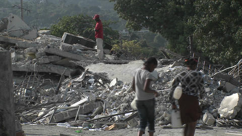 People sift through the rubble following the Haiti Stock Video Footage