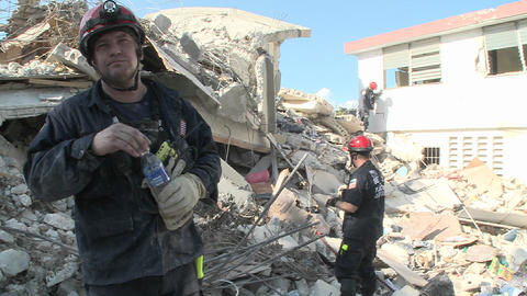Rescue workers search among piles of rubble after Stock Video Footage