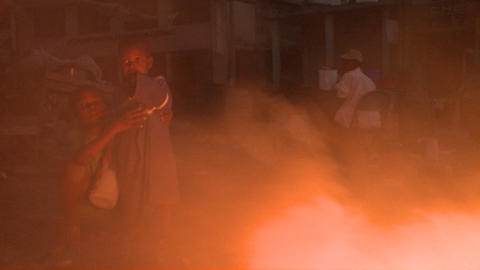 An open fire burns on the streets of Haiti followi Stock Video Footage