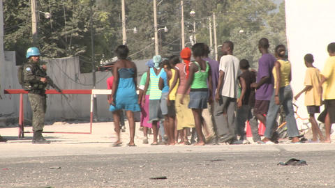 Long lines of refugees wait on the streets of Hait Footage