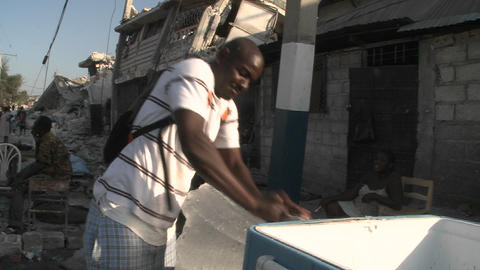 A man sells ice on the streets following the massi Stock Video Footage