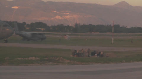 A military cargo plane taxis on the runway in Hait Footage