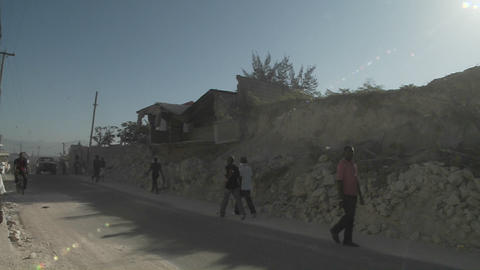 Rubble lines the streets following the earthquake Stock Video Footage