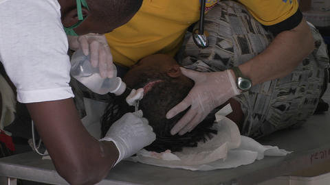 Doctors work in a trauma center to treat a serious Stock Video Footage
