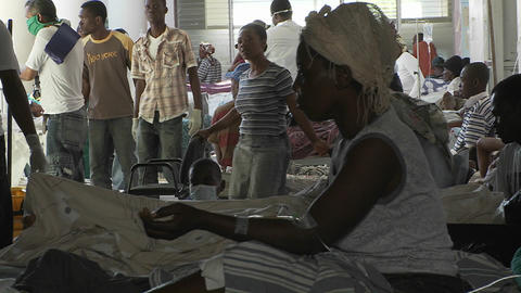 Injured victims of the Haiti earthquake wait outsi Footage
