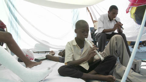 Men in a refugee center play flutes following the Stock Video Footage