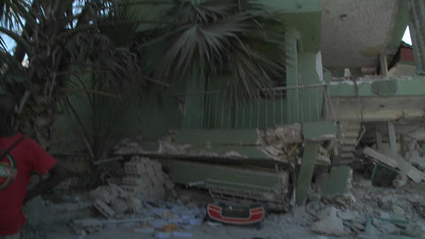Flattened buildings on the streets of Haiti follow Stock Video Footage