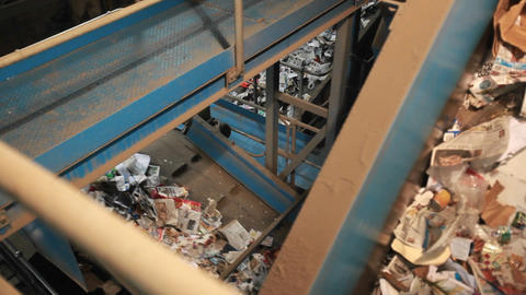 Recycling materials travel on conveyor belts in a  Footage