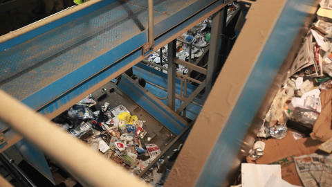 Recycling materials travel on conveyor belts in a Stock Video Footage