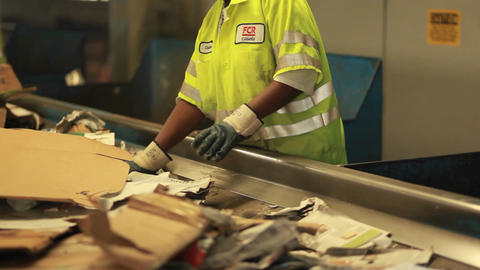 Workers sort trash at a recycling center Footage