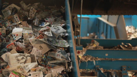 Recycled materials travel on a conveyor belt at a  Footage