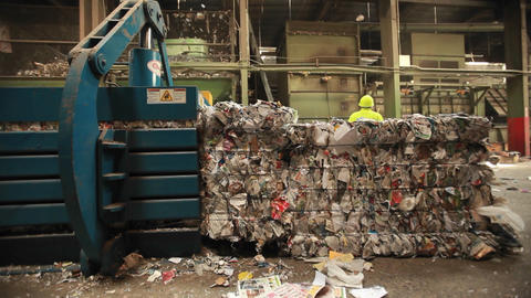 Workers around pallets of recycle materials Footage