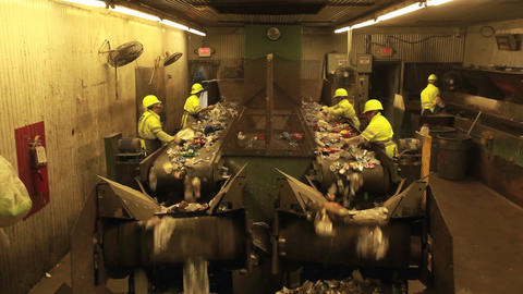 Workers sort plastic bottles in a recycling center Stock Video Footage