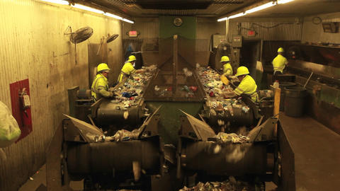 Workers sort plastic bottles in a recycling center Footage