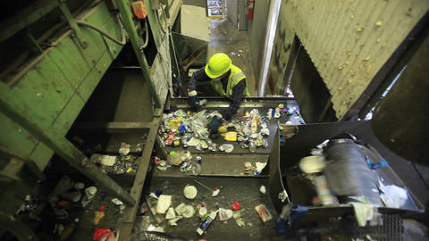 High angle view of workers sorting trash at a recy Stock Video Footage