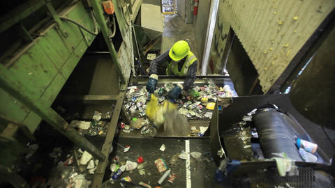 High angle view of workers sorting trash at a recy Footage