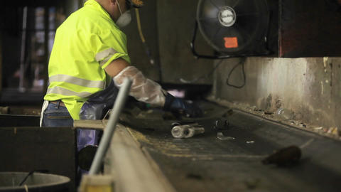 Workers sort trash on a conveyor belt at a recycli Stock Video Footage