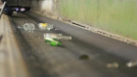 Bottles and cans move along a conveyor belt at a r Stock Video Footage
