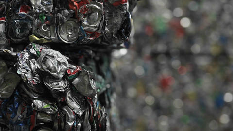 Patterns of crushed aluminum cans in a recycling c Stock Video Footage