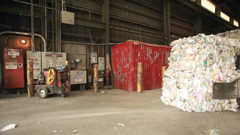 Step motion of a skip loader moves aluminum cans a Stock Video Footage