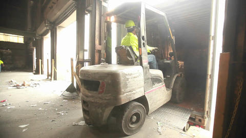 Skip loaders move aluminum blocks at a recycling c Footage