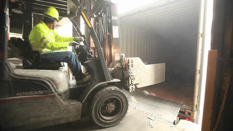 Skip loaders move aluminum blocks at a recycling c Stock Video Footage