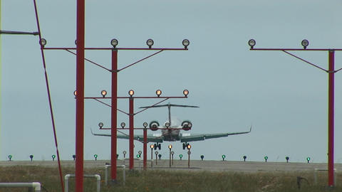 A jet airplane lands on an airport runway Footage