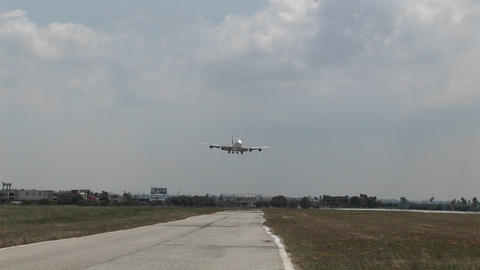 A Singapore Airlines 747 landing at a generic airport Stock Video Footage