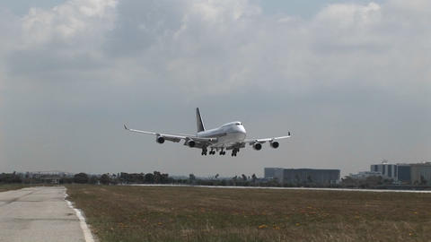 A Singapore Airlines 747 landing at a generic airport Footage