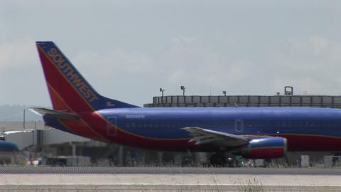 A jet taxis quickly on an airport runway Footage