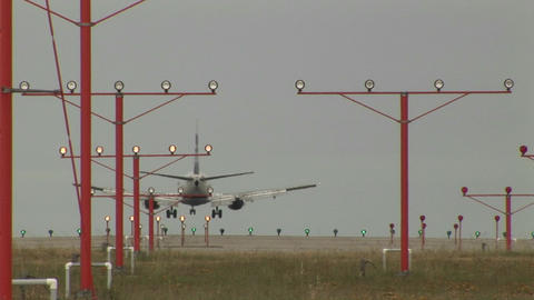An airplane landing on a runway through lights and... Stock Video Footage