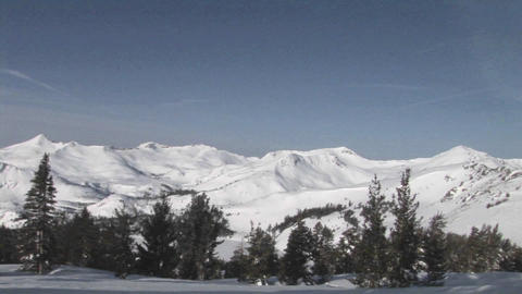 Pan-right across snow-covered rugged mountains Stock Video Footage