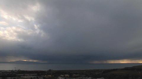 Storm clouds threaten a coastal town Footage
