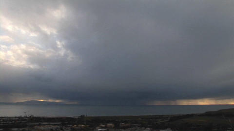 Storm clouds threaten a coastal town Stock Video Footage