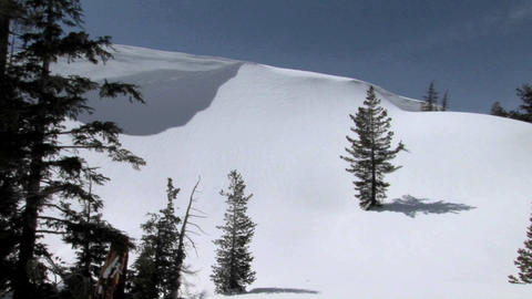 Long shot of a snowboarder on a pristine mountain slope Stock Video Footage