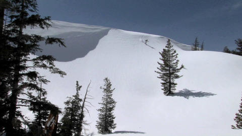 Long shot of a snowboarder on a pristine mountain slope Footage