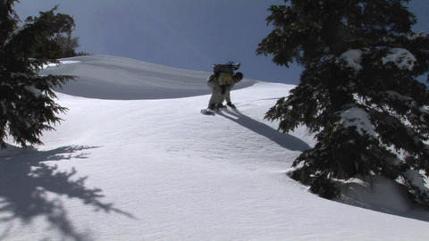 Medium shot of a snowboarder passing and leaving powder on the lens of the camera Footage
