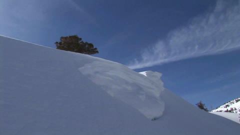Following shot of a snowboarder as he makes a thrilling... Stock Video Footage
