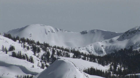 Pan-down shot of hikers moving up a steep and snowy... Stock Video Footage