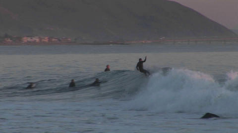 A surfer rides an ocean wave along the California coast Stock Video Footage