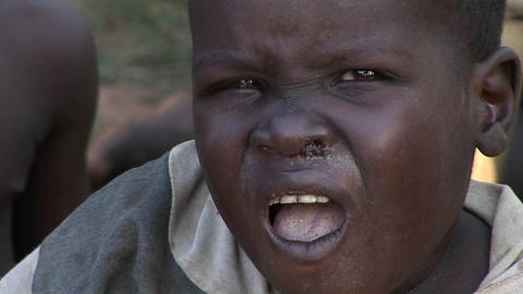 A young child stares ahead in Uganda, Africa Stock Video Footage