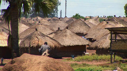 Huts stand in a refugee camp in Northern Uganda Stock Video Footage