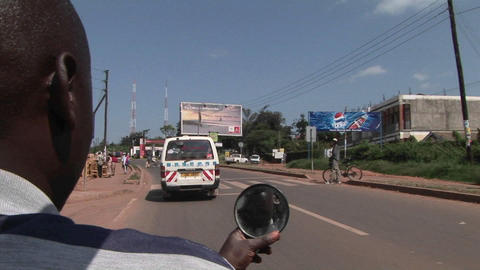 A motorcycle drives down a busy highway in Africa Footage